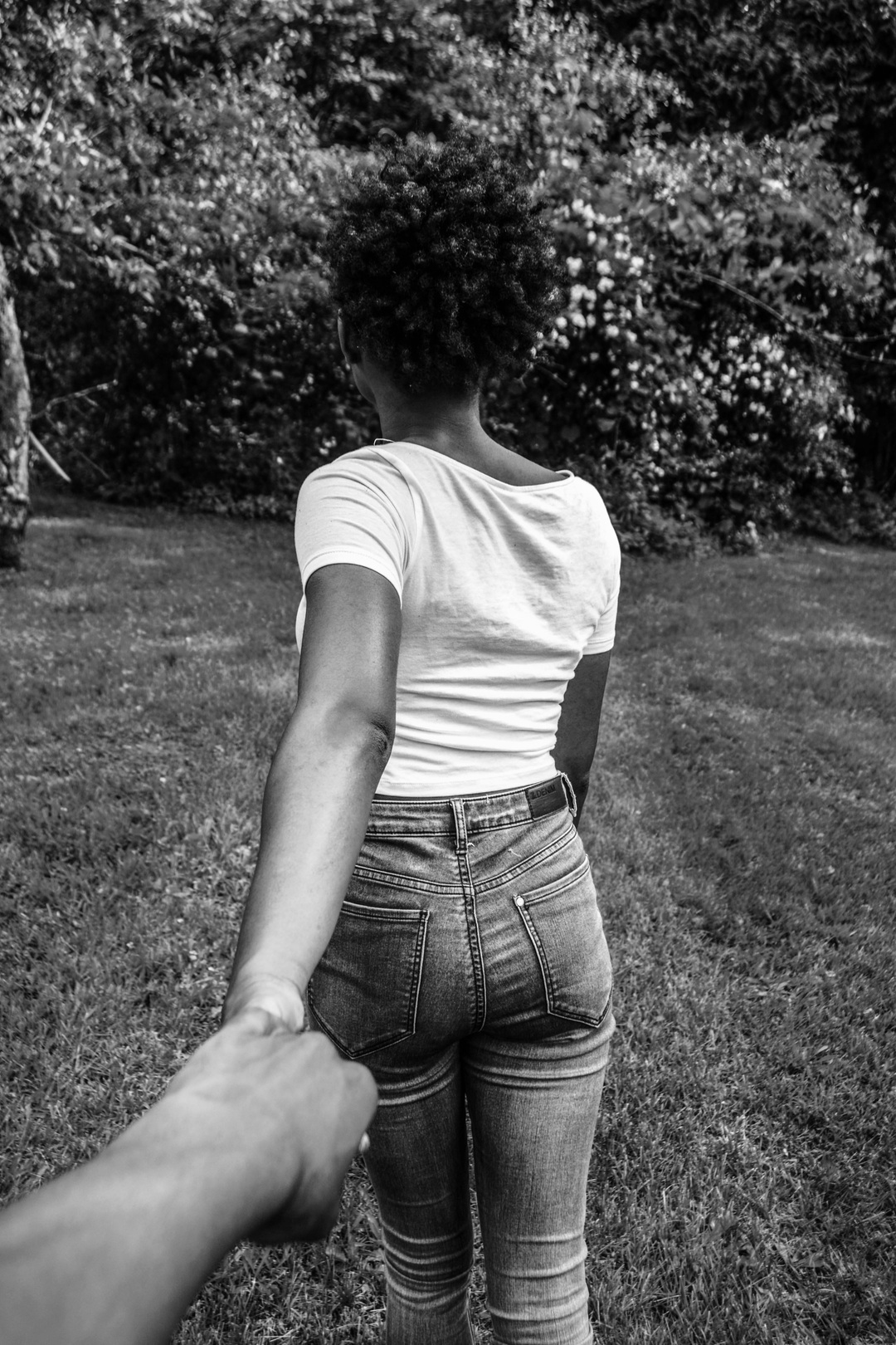 black woman leading her man by the hand